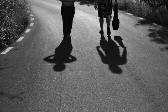 mother_and_son_walking_by_Panaer